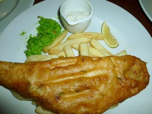 Fish & chips £11.50 sustainably caught hake in a cider batter with pea puree, tartare & chip shop chips £11.50